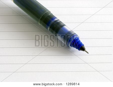 Closeup Notepad And Pen