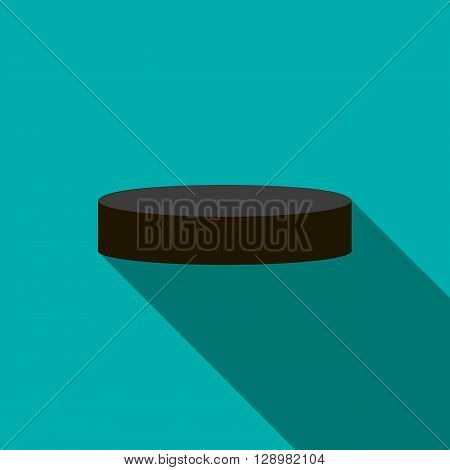 Hockey puck icon in flat style on a blue background