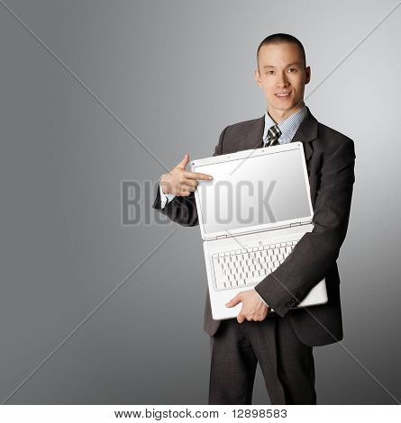 Businessman With Open Laptop Shows Something