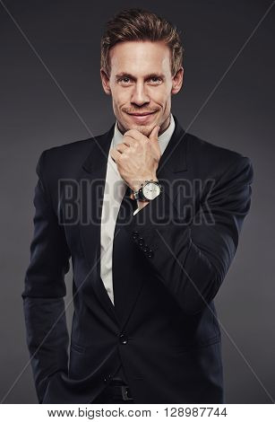 Thoughtful Stylish Businessman On Grey