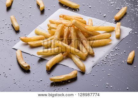 Fries On A Black Table With Sea Salt