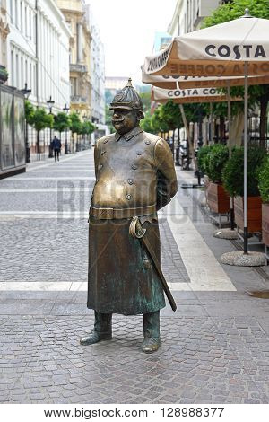 BUDAPEST HUNGARY - JULY 13: The Fat Policeman Statue in Budapest on JULY 13 2015. The Fat Policeman With Big Brass Belly Monument at Zrinyi Street in Budapest Hungary.