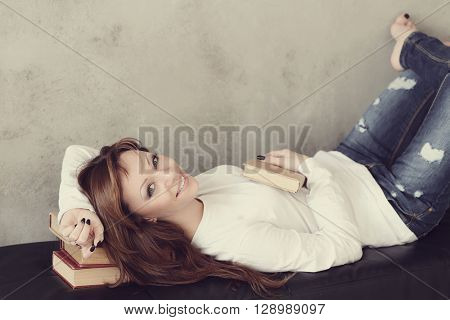 Beautiful woman on a tufted bench