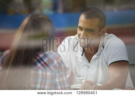 Couple enjoying their love at the restaurant