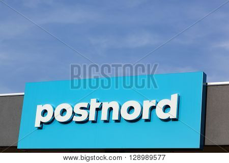 Esbjerg, Denmark - May 6, 2016: Postnord logo on a wall. PostNord is the name of the holding company of the two merged postal companies Posten AB and Post Danmark that were officially merged in 2009