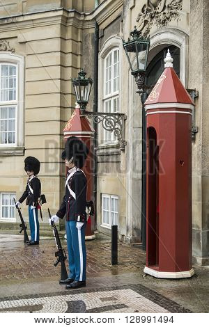 COPENHAGEN, DENMARK - JANUARY 2, 2014: unidentified soldiers of the Royal Guard in Amalienborg Castle guarding an entrance on January 2, 2014 in Copenhagen, Denmark
