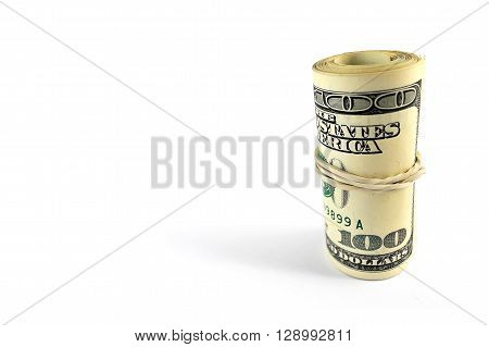 roll of banknotes nominal value of one hundred US dollars