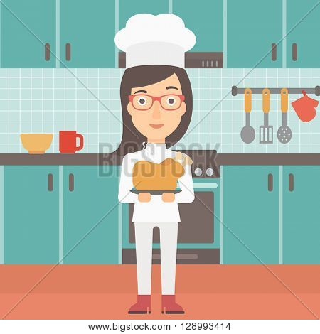 Woman holding roasted chicken.