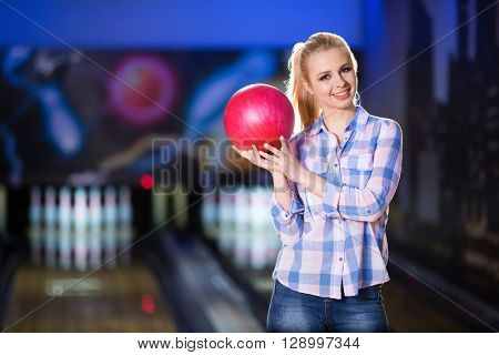 Smiling woman with bowling ball