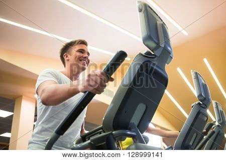 Smiling man on elliptical