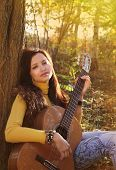 Beautiful Brunette Guitar Player Girl