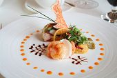picture of gourmet food  - starter or entree of a french dish with seafood mixed among salad leaves - JPG