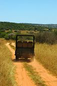 pic of loamy  - a typical african vehicle on safari driving on a loamy soil road showing tourists the beauty of an african safari  - JPG
