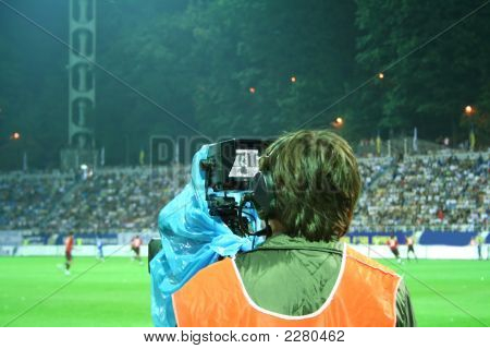 Cameraman On The Stadium