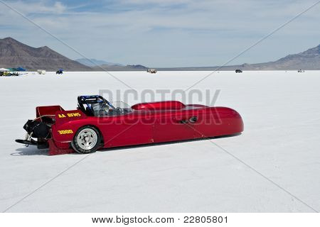 WENDOVER, UT - AUGUST 13: Bonner's Bad Berkeley, a 1959 Berkeley, races on the Bonneville Salt Flats during Bonneville Speed Week on August 13, 2011 near Wendover, UT.