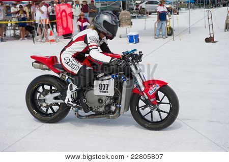 WENDOVER, UT - AUGUST 13: A 1000cc Honda motorcycle races on the Bonneville Salt Flats during Bonneville Speed Week on August 13, 2011 near Wendover, UT.