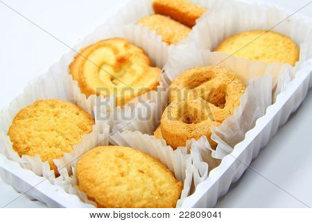 Variety Of Assorted Tea Time Biscuits Isolated On A White Background