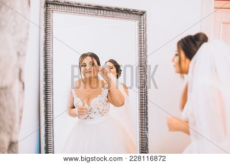 poster of Wedding Earrings On A Female Hand, She Takes The Earrings, The Bride Fees, Morning Bride, White Dres