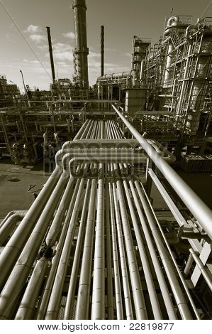 pipelines, oil, gas and fuel, inside view of refinery in brown toning.