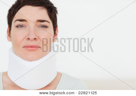 Close up of a sad Woman with a surgical collar in a waiting room
