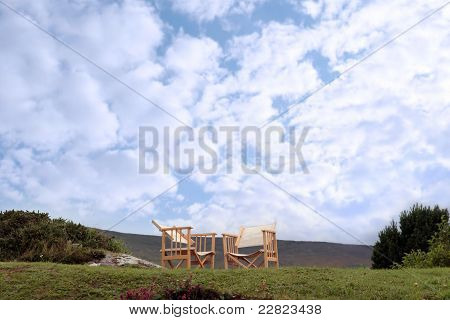 Two Chairs On A Hill