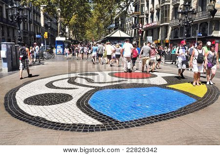 BARCELONA, SPAIN - AUGUST 16: Joan Miro's Pla de l'Os mosaic in La Rambla on August 16, 2011 in Barcelona, Spain. Thousands of people walk daily on the mosaic, designed by famous artist Joan Miro