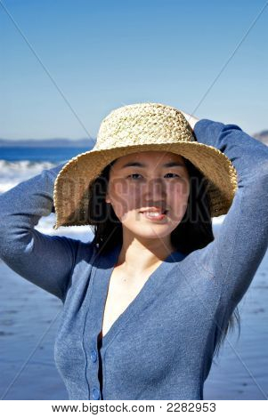 Attractive Smiling Young Asian Woman With Big Straw Hat