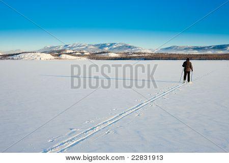Cross-country Skier On Frozen Lake