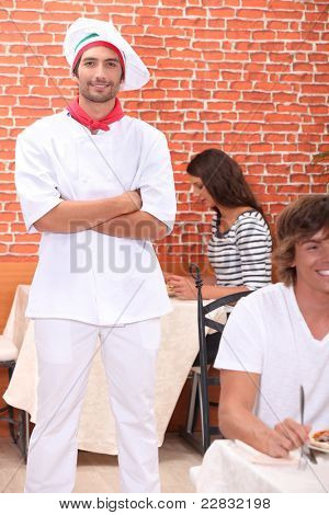 Cook standing in a restaurant