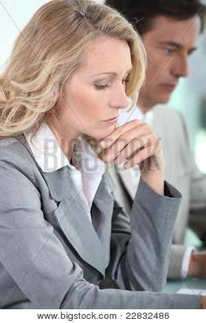 Woman thinking in meeting