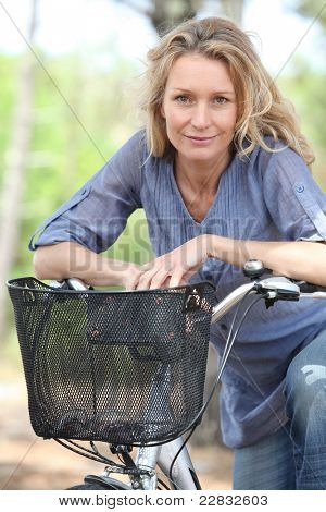 Woman riding bike in forest