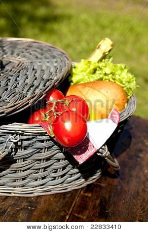 Picnic Basket With Vegetables And Bread