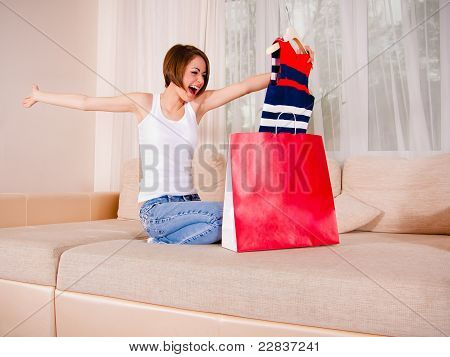 Young female is satisfied with her purchase