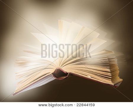 opened book falling down