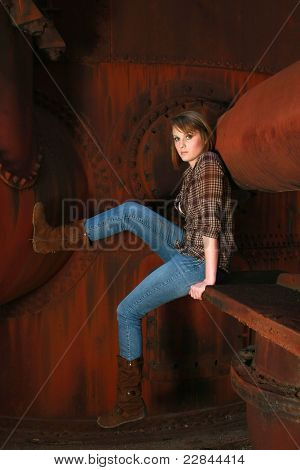 Young Woman Against Old Rusty Metal