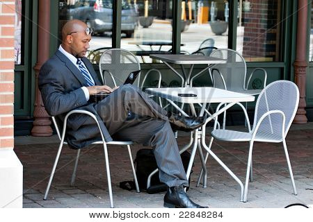 Business Man Working On His Laptop Outdoors