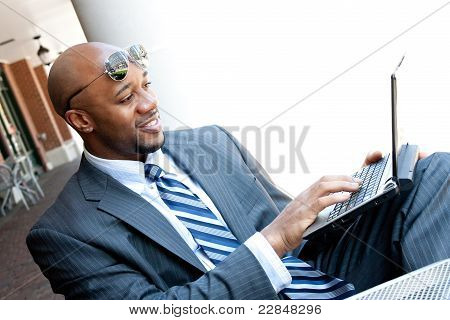 Mobile Business Man Working On A Laptop
