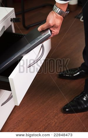 Businessman Taking Documents