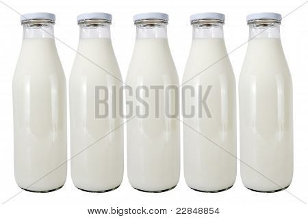 Five Glass Bottles With Milk