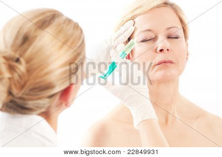 - Age and beauty; a doctor is doing the injection