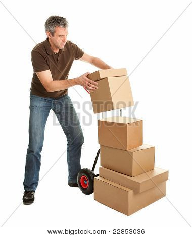 Delivery man staking packages on hand truck
