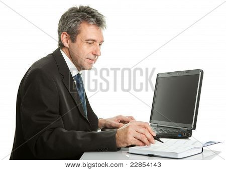 Senior business man working on laptop