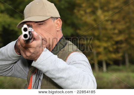 Hunter looking down the barrel of a gun