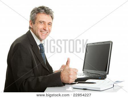 Senior business man working on laptop