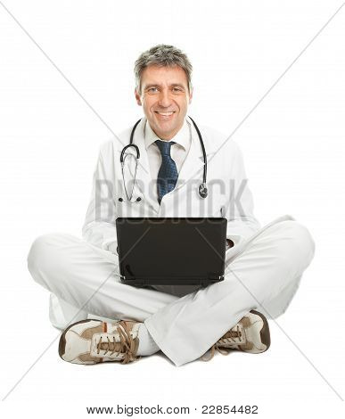 Medical doctor working on laptop