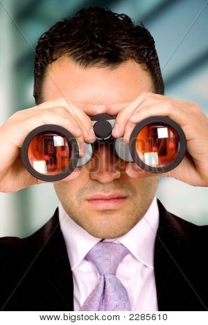 Business Man With Binoculars
