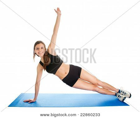Fitness woman doing aerobics on gym mat