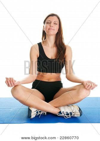 Fitness woman sitting in lotus yoga position