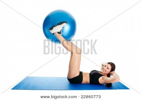 Fitness woman doing crunches on gym mat