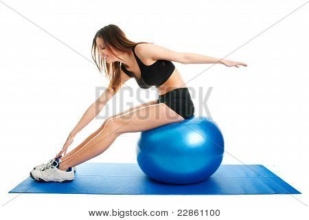 Fitness woman stretshing on fitness ball